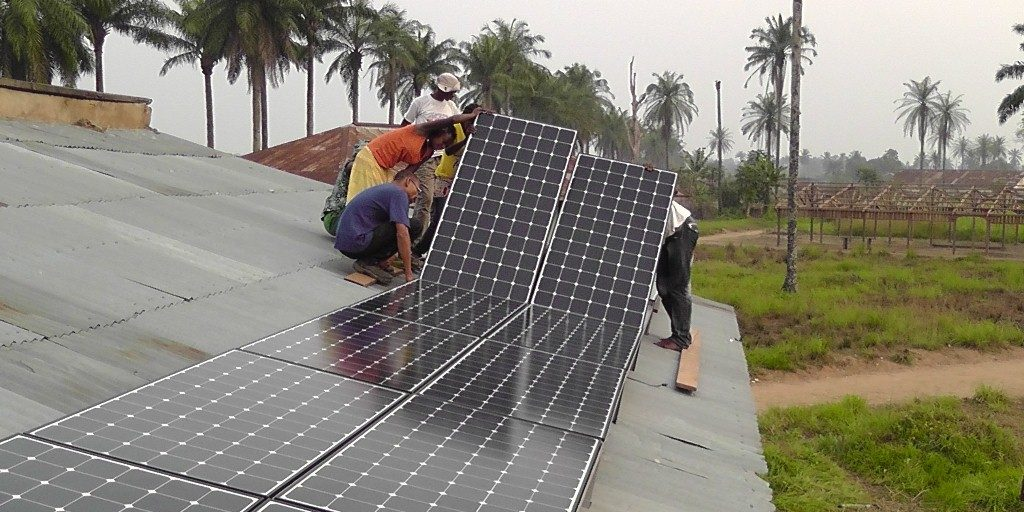 installation-of-16-solar-panels-for-the-radio-in-Oshwe-part-of-volunteers-training.jpg