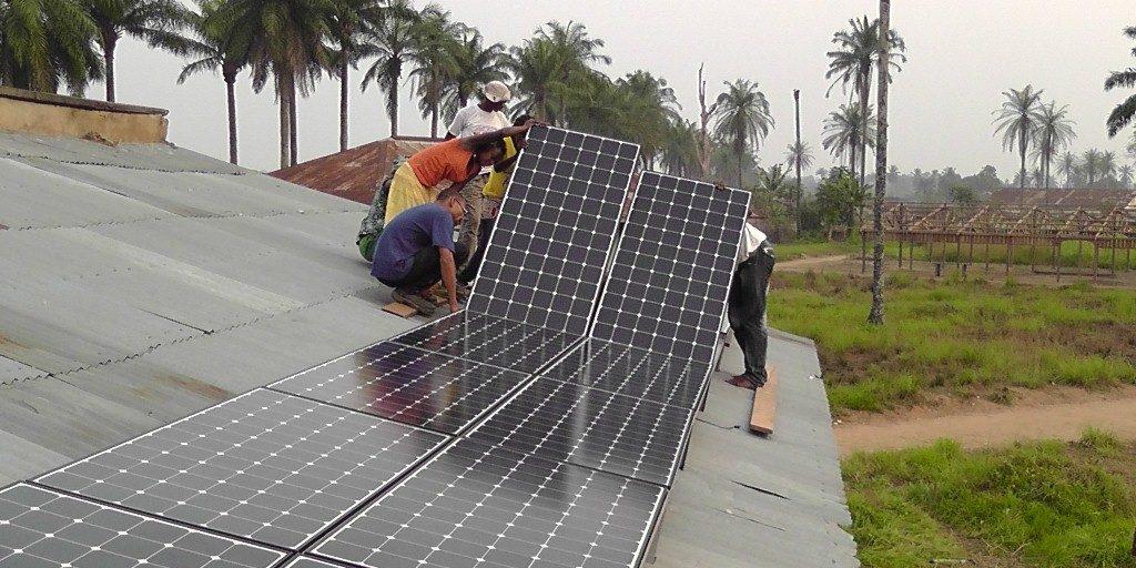 installation-of-16-solar-panels-for-the-radio-in-Oshwe-part-of-volunteers-training.jpg